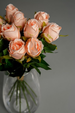 A bouquet of artificial peach roses.