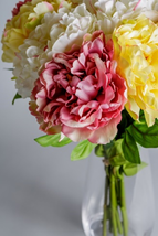 An arrangement of faux mixed peonies.