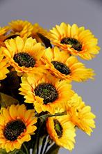 An arrangement of artificial sunflowers.